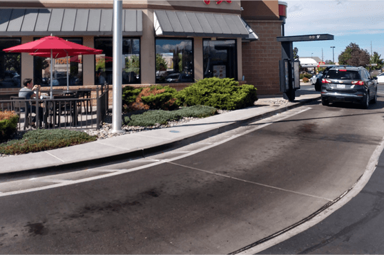 Fast food restaurant drive through with oil stained concrete