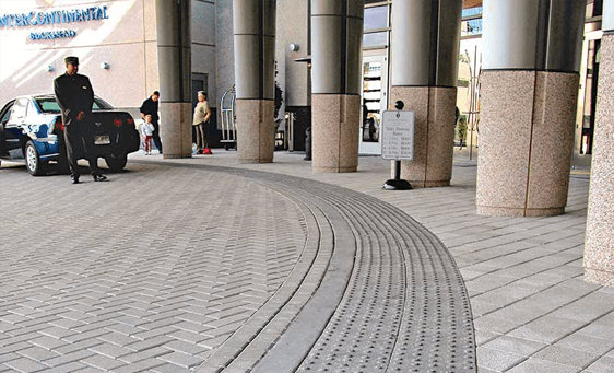 Hotel concrete paver drive through with clean concrete